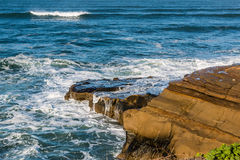 Ocean Waves and Rock Formations at Sunset Cliffs Royalty Free Stock Photography
