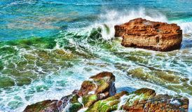 Ocean waves on rocks royalty free stock images
