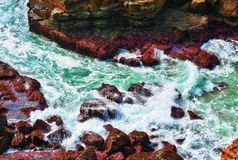 Ocean waves on rocks Stock Image