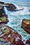 Ocean waves on rocks Stock Images