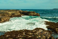 Ocean waves and rocks at Pebbly Beach NSW stock photos