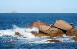 Ocean waves on rocky coast Stock Images