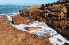 Ocean waves on rocky coast Royalty Free Stock Photos