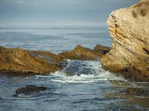 The Ocean Waves Roll Over the Rocky Shoreline. At Montana de Oro State Park, Los Osos, California Stock Image