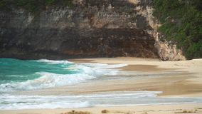 Ocean waves rolling to the sandy beach. Clear pure transparent water in the lagoon, Nusa Penida, Indonesia. Ocean waves rolling to the sandy beach. Clear pure stock video footage