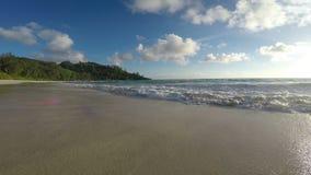 Ocean waves run ashore stock footage