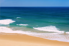 Ocean waves and sand beach in Portugal Royalty Free Stock Photos