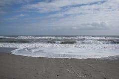 Sandy beach and waves, ocean shore. Ocean waves, sandy beach, nobody around. Wonder land, tropical paradise. Beach home Stock Images