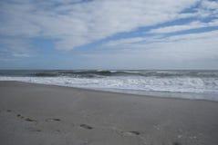 Sandy beach and waves, ocean shore stock photo