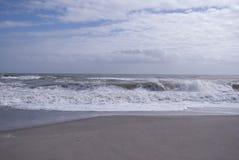 Sandy beach and waves, ocean shore. Ocean waves, sandy beach, nobody around. Wonder land, tropical paradise Stock Photos