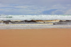 Ocean waves on sandy shore Royalty Free Stock Photography