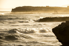 Shore cliff. Ocean waves shattering on shore cliff Royalty Free Stock Photography