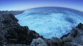 Ocean waves smashing the rocks stock video