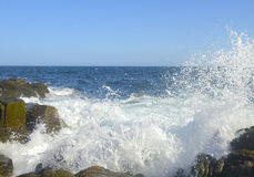 Ocean Waves Splashing over Rocks Royalty Free Stock Images