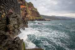 Ocean waves and steep rocks of Madeira island. Ocean waves and steep rocks of Madeira island landscape. Ponta do Sol, Madeira, Portugal Royalty Free Stock Photos