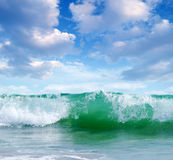 Ocean waves on a sunny day Stock Photos