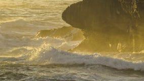 Ocean Waves during Sunrise in Hawaii. Ocean waves during sunrise on the island of Oahu in Hawaii splash against the rocks royalty free stock images