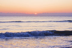 Ocean waves during sunrise Royalty Free Stock Photo