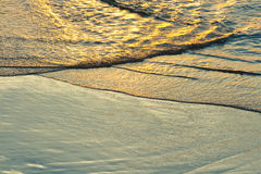 Ocean waves. Sunset and ocean waves. Golden seashore in Thailand Royalty Free Stock Image