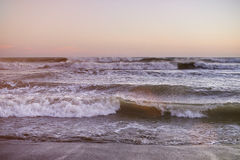 Ocean waves on sunset time Royalty Free Stock Photo