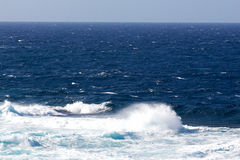 Ocean waves and surf in  sunlight Royalty Free Stock Photo