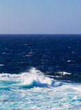 Ocean waves and surf in sunlight Stock Photo