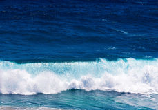 Ocean waves and surf in sunlight Stock Photos