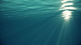 Ocean waves from underwater looping animation High quality Light rays shining through. Great popular marine Background. High quality Looping animation of ocean stock video