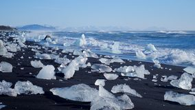 Ocean waves washed icebergs. Global warming problem. Ocean waves washed icebergs on the black beach Iceland stock video footage
