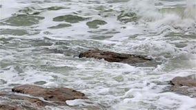 Ocean waves washing over rocks stock video footage
