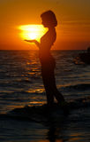 Ocean woman in sunset light Stock Photos