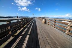 Ocean wooden pier in San Francisco Bay at hot summer day royalty free stock photos