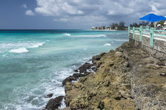 Ocean at Worthing beach Barbados. Waves rolling into Worthing Beach on the south coast of the Caribbean Island of Barbados in the West Indies Stock Image