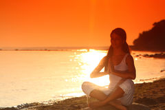 Ocean yoga sunrise Stock Photo