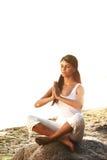 Ocean yoga sunrise. Young woman practicing yoga  near the ocean Royalty Free Stock Image