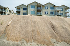 Oceanfront condos and beach dune erosion. Westport, WA, USA June 11, 2017: Burlap netting covering beach dunes in effort to prevent further erosion threatening Royalty Free Stock Photo