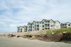 Oceanfront condos and beach dune erosion. Westport, WA, USA June 11, 2017: Burlap netting covering beach dunes in effort to prevent further erosion threatening Royalty Free Stock Images