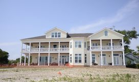 Oceanfront Home, Gulfport Mississippi. An oceanfront home with maintenance repairs being conducted on it sitting on the oceanfront of the Gulf Coast of Mexico in Stock Photography