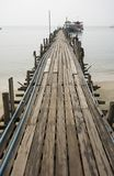 Oceanfront pier. A narrow oceanfront pier extending out into the water at a beach in Thailand Stock Photo