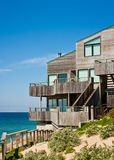Oceanfront Townhome. An modern oceanfront townhouse adjacent to a landscaped sand dune with wooden decks and siding Stock Photos