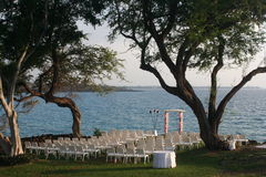 Oceanfront wedding. Chairs and arch set up for oceanfront wedding, Hapuna Beach, Hawaii Stock Image