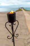 Oceanfront Wedding Torch Stock Photos