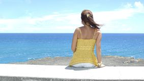 Oceangirl wide (Panoramic). Wide shot of girl looking out to sea Royalty Free Stock Photography