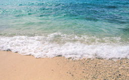 Oceanic wave over white sand beach. Marine scene with sand beach and sea wave. Royalty Free Stock Photography