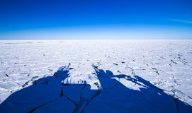 Oceanography in Antarctica. Shadow of a polar research vessel over the frozen southern ocean