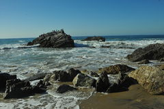 Oceanside beach and rocks Royalty Free Stock Photo