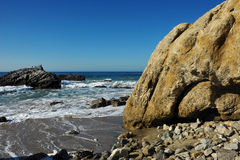Oceanside beach and rocks. At Leo Carill Beach near Malibu in California, USA Royalty Free Stock Images