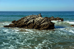 Oceanside beach and rocks Royalty Free Stock Photos