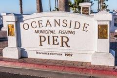 Sign Marker for Entrance to Oceanside Pier. OCEANSIDE, CALIFORNIA/USA - FEBRUARY 24, 2018: Sign marker for the Oceanside Pier placed at the entrance when it was stock photography