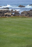 Oceanside Golf. View of greens at Pebble Beach golf course along 17-Mile Drive on Northern California coast between Monterey and Carmel. Greens in foreground and Royalty Free Stock Photography
